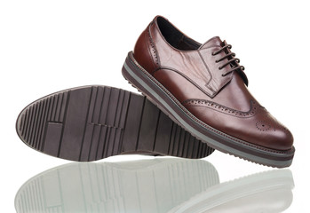 Pair of brown male shoes on white background