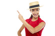 Smiling woman wearing straw bowler hat pointing away
