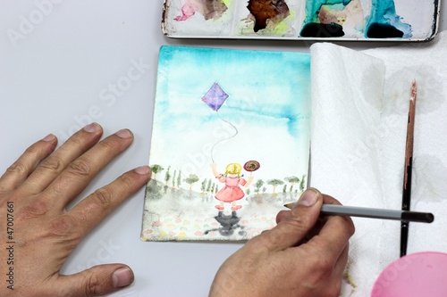 artist working with pastel on an illustration