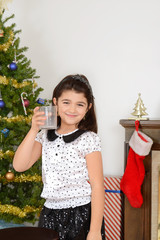 Little girl drank santa milk