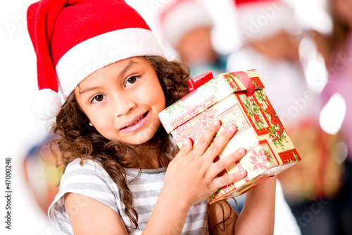 Adorable girl holding a Christmas present