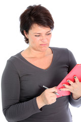 Woman grimacing at what she is reading