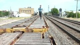 Businessman Running - Jumping Over Train Cars