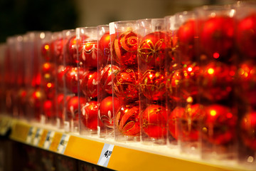 sale of red christmas baubles