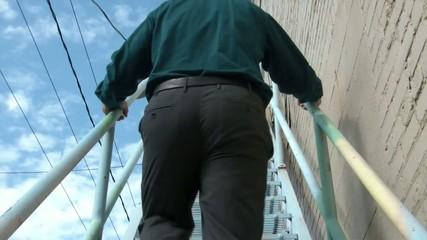 Businessman Walking Upstairs Downtown