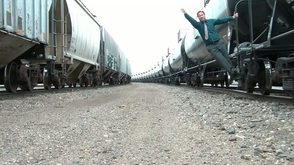 Businessman on Moving Train Jumps Off