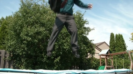 Businessman Jumping on Trampoline, Crazy