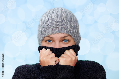 Young woman with pullover and cap in winter