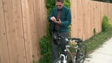 Businessman on Tablet - Riding Bike to Work