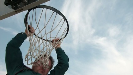 Businessman Misses Dunking Basketball