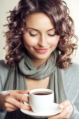 Beautiful Woman drinking Coffee or Tea