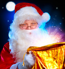 Christmas Santa. Santa Claus opening Magic Bag with Gifts