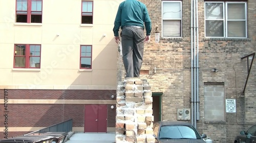 Businessman Walks Narrow Ledge