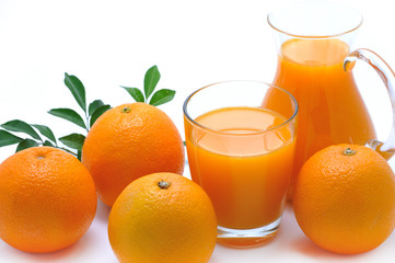 Orange juice in glass and jug and orange