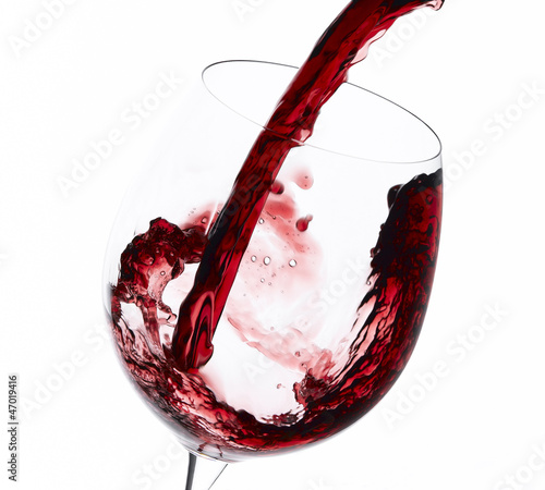 Pouring red wine to wine glass