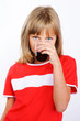 closeup portrait of twin girl drinking soda over white backgroun
