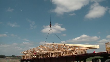 A Frame Lifted Into Air by Crane Construction
