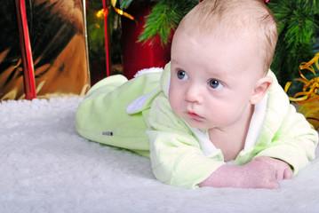 Small breast child near new year's fir tree