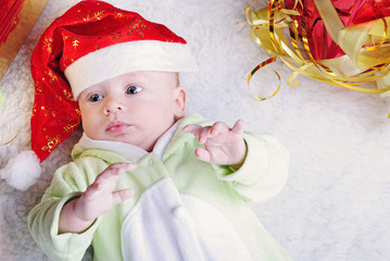 Small breast child near new year's fir tree with gift