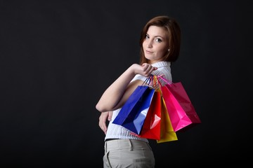 young woman with shopping bags (focus on bags)