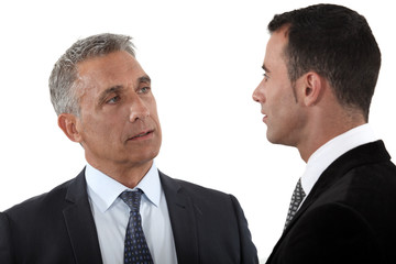 Boss chatting to younger employee