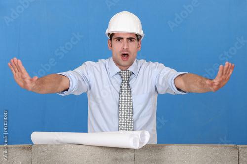 Architect gesturing stop