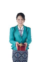 Portrait of beautiful Asian woman holding a gift box