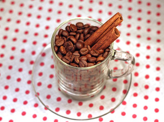 coffee beans in a glass cup with cinnamon, close-up