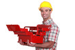 Worker with an open toolbox