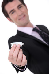Businessman holding a memory stick