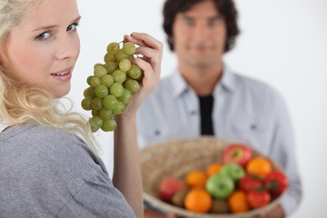 Couple stood with fruit basket