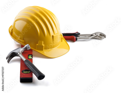 isolated hard hat with tools on white