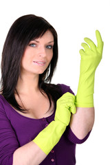 Brunette putting on rubber gloves