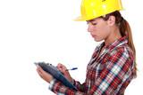 Tradeswoman filling in paperwork