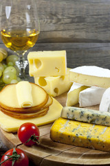 Cheese and wine various assortment vintage still life