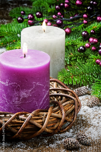 Burning candles on festive Christmas background