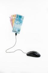 Mouse conectado a notas de dinheiro brasileiro