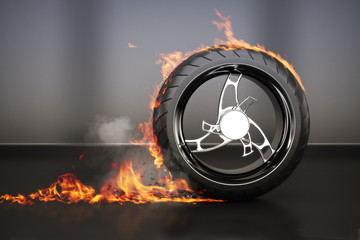 Tire burnout with flames smoke and debris
