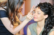 Applying wedding make-up by make-up artist