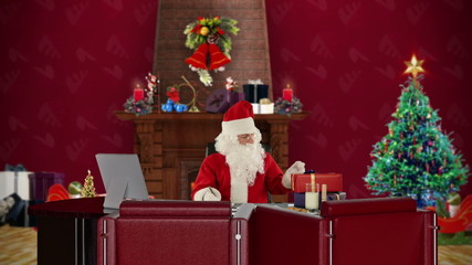 Santa Claus reading letters, office with Christmas decor