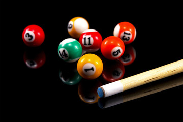 Billiard balls & Pool stick  composition.Isolated on black