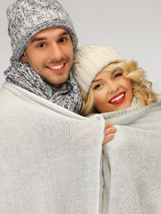 family couple under warm blanket