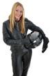 Junge Frau in Motorradkombi trägt Helm