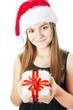 christmas girl holding present isolated over white