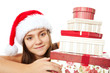 christmas girl holding presents isolated over white