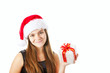 christmas girl holding present isolated over white