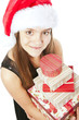 smiling christmas girl holding presents over white