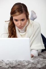 Young woman concentrating on her work