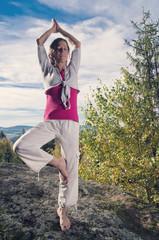 Standin Yoga on a Rock