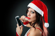 girl wearing santa claus clothes with smartphone
